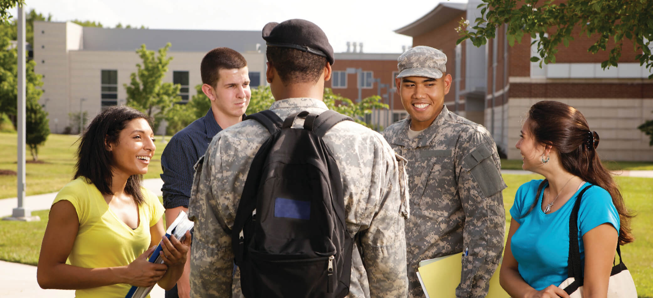 Student service members and other students gather on a campus