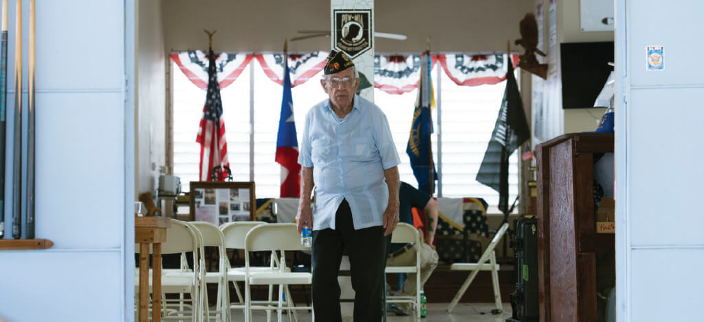 Veteran stands in a veterans hall