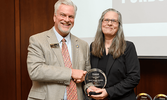 MFRI director and staff member presented with honors