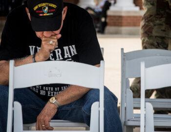 Veteran sits in silence at a memorial service