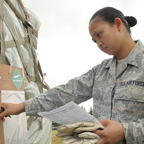 Female military student looking through papers